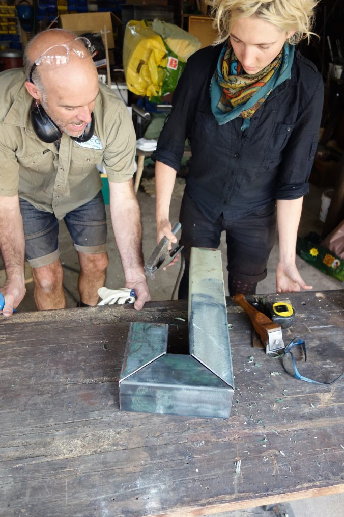Joel Meadows and Margaux make a rocket stove