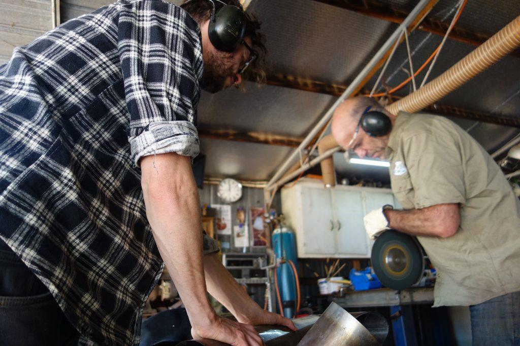 Adam making rocket barrel oven on one of our workshops